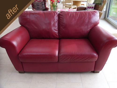 Worn red leather sofa treated and colour fully restored - after