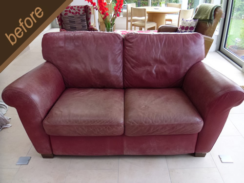 Worn red leather sofa treated and colour fully restored - before